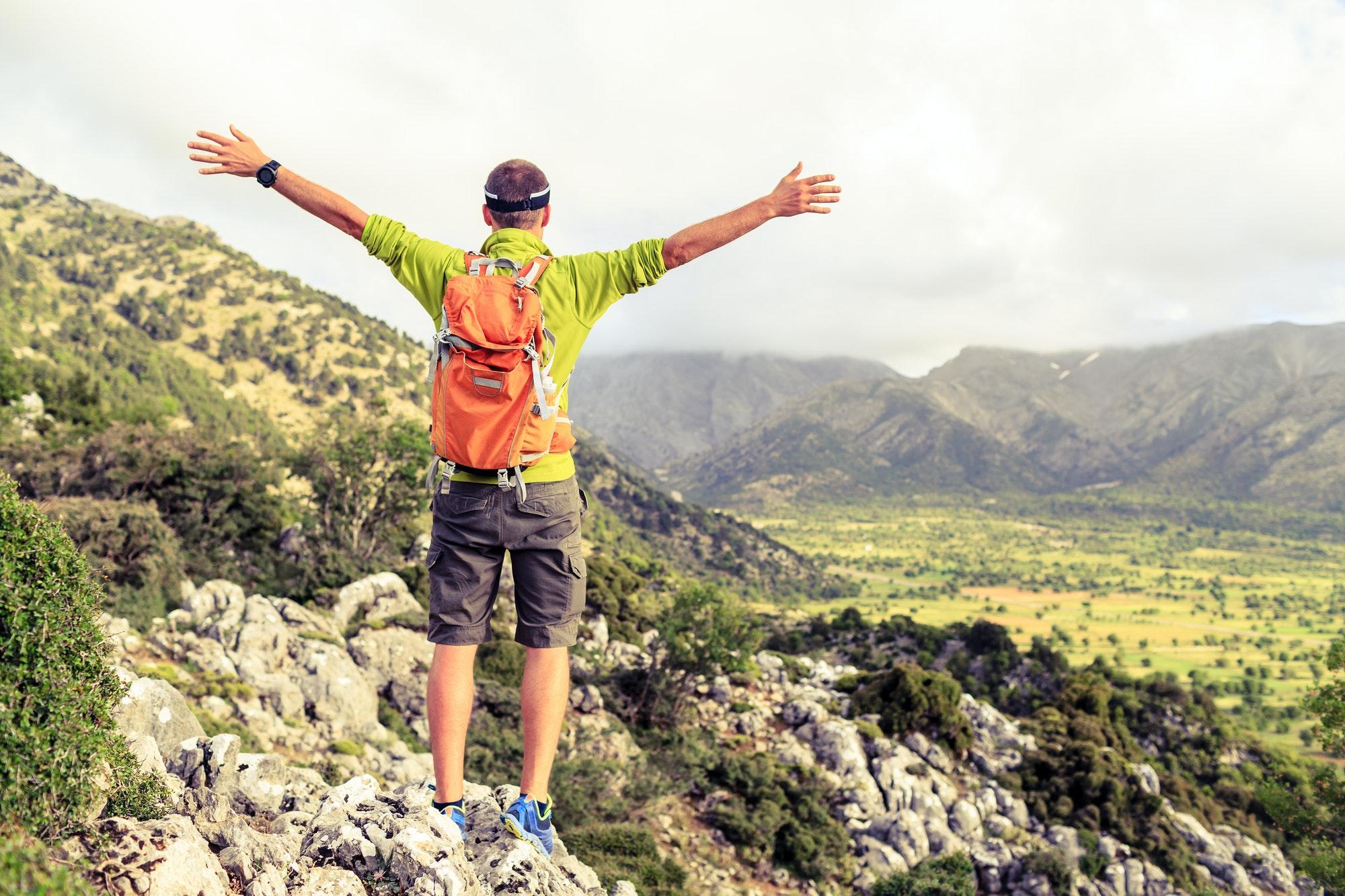 Happy success winner, life goal success hiker man